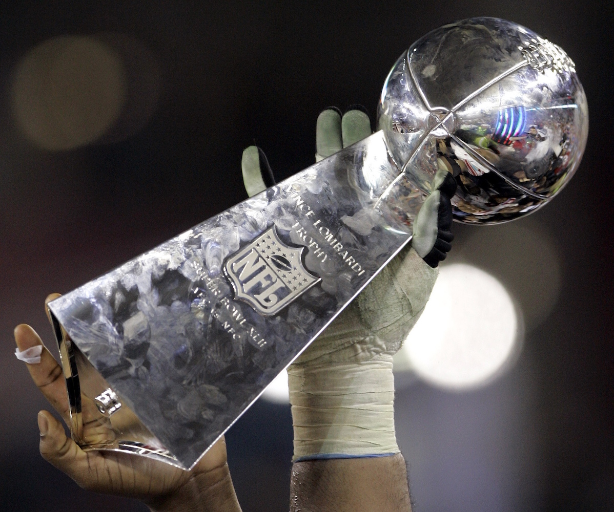 New York Giants players hold up the Vince Lombardi trophy after the Giants beat the New England Patriots 17-14 to win the Super Bowl XLII football game in Glendale, Ariz, on Sunday, Feb. 3, 2008. (AP Photo/Eric Gay)