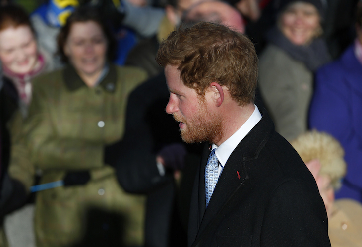 Britain's Prince Harry walks to a Christmas Day morning service at the church on the Sandringham Estate in Norfolk, eastern England, December 25, 2013. REUTERS/Andrew Winning  (BRITAIN - Tags: ROYALS RELIGION) - RTX16TQA