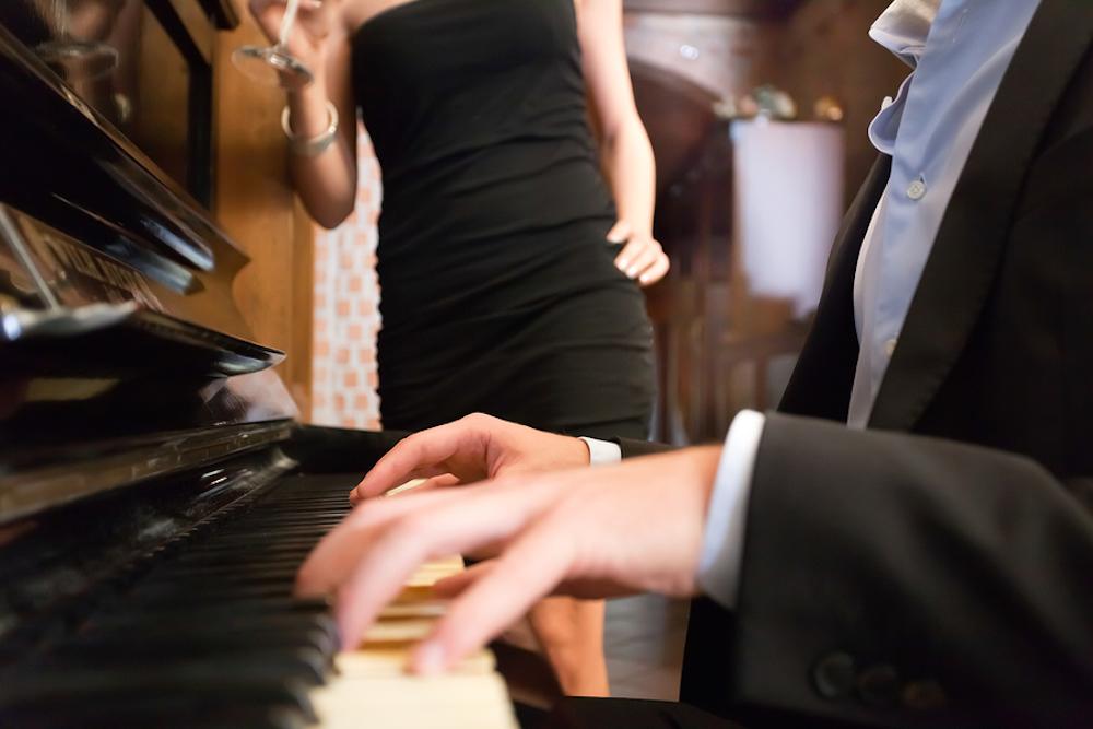 bigstock-Man-playing-piano-for-his-girl-41608657